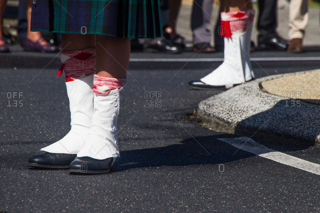 Person wearing Scottish shoes during Anzac Day event