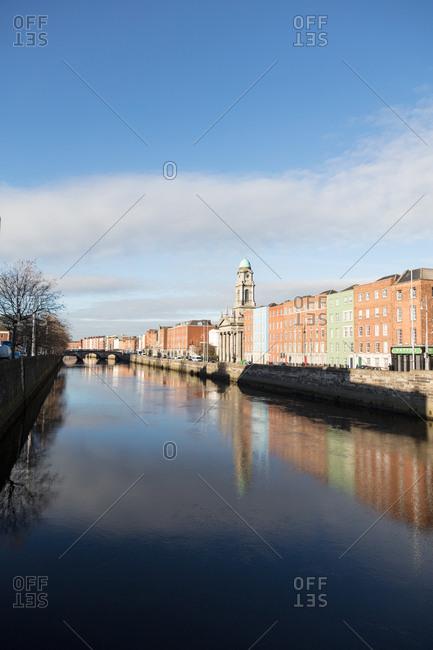 Dublin, Ireland - 01 December, 2017: Liffey River and Saint Paul's Church