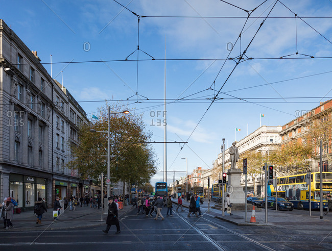 Dublin, Ireland - 01 December, 2017: O'Connell Shopping Street and Sir John Gray Statue, Dublin Spire