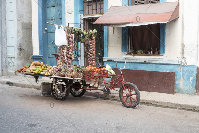 Havana, Cuba - March 14, 2015: Unmanned pedal powered vegetable cart parked on the side of the road
