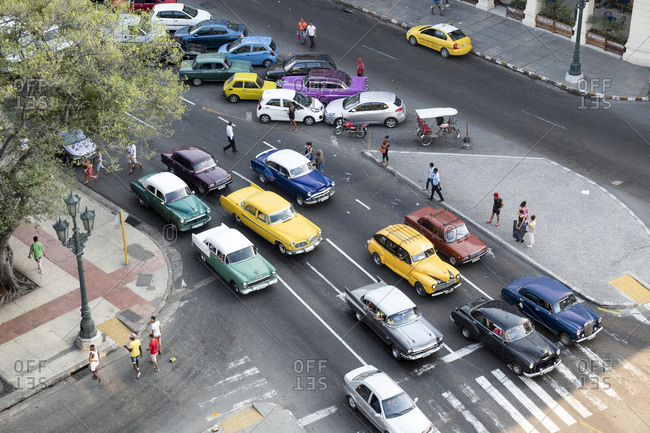 Havana, Cuba - March 23, 2015: High angle view of vintage and new cars at intersection