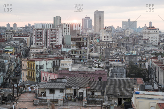 Havana, Cuba - March 23, 2015: High angle cityscape with sun setting behind taller buildings of downtown