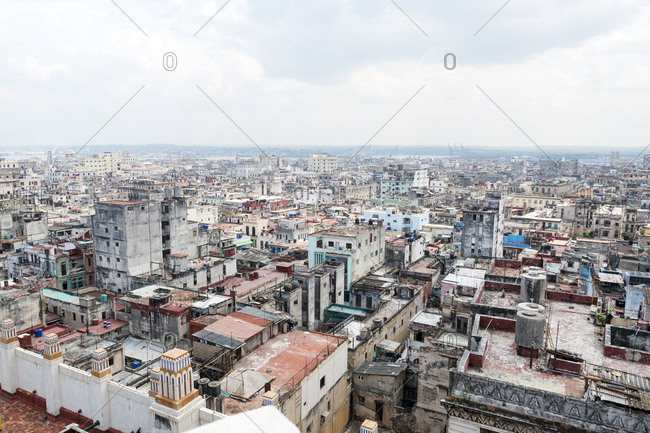 Cityscape looking out over densely packed low rise rooftops of Havana, Cuba