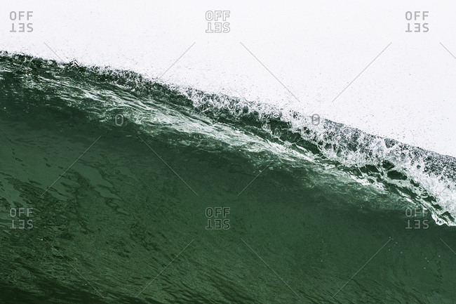 Looking up at lip of breaking wave from water level