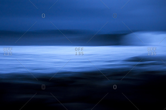 Abstract image of wave breaking on dark and overcast day
