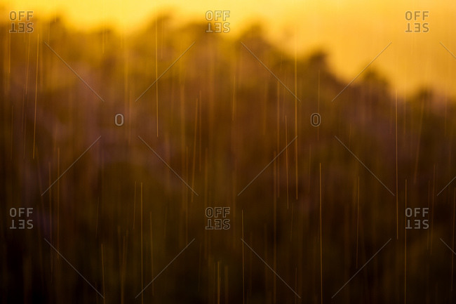 Abstract image of rain drops blurred by motion at sunset