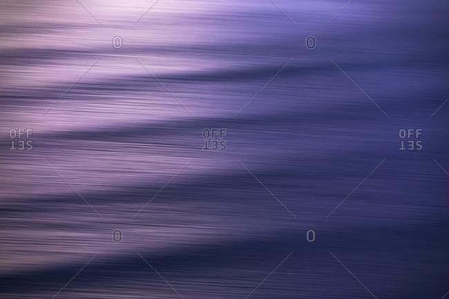 Abstract image of ripples on surface of sea at dusk