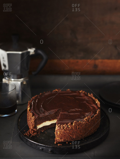 Chocolate cheesecake with a slice cut out