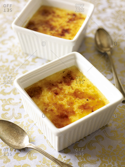 Two square dishes of creme brulee