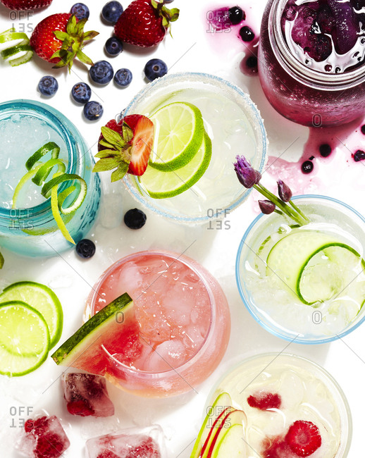 Various drinks with a variety of garnishes