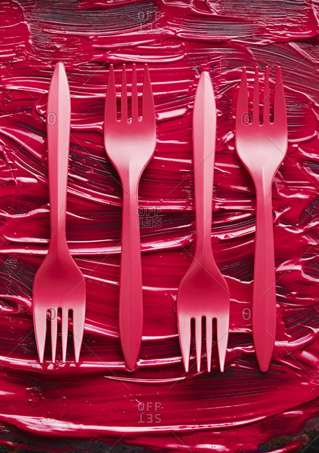 Pink forks on a painted backdrop