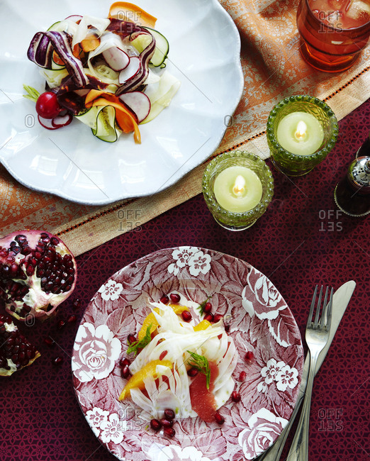 Two summer salads in a table setting