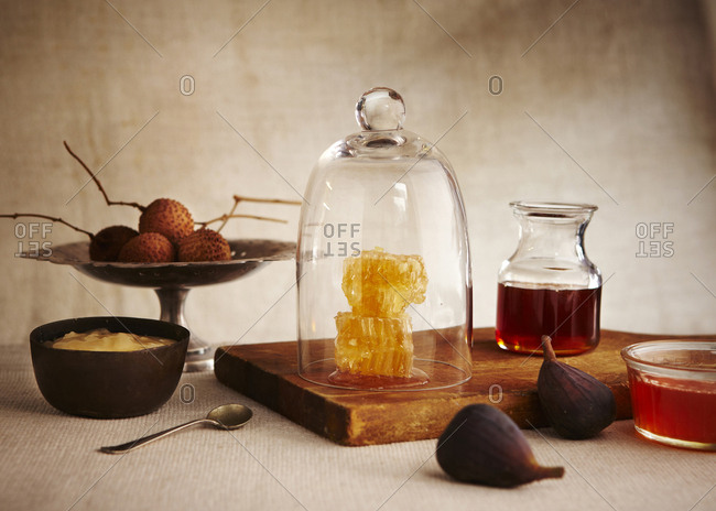 Still life with honey comb figs and fruit