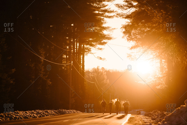 Runners running outside on a cold morning