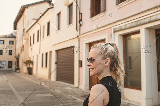 Blonde woman in the streets of Portogruaro, Italy