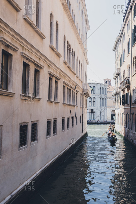 Venice, Italy - July 6, 2017: Tour boat on a canal