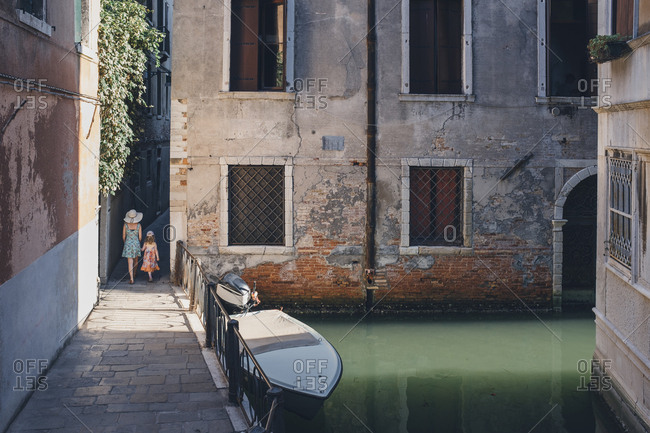 Mother and daughter walking in Venice, Italy