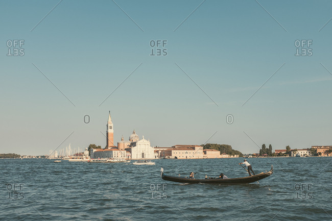 Venice, Italy - July 6, 2017: Photographer photographing couple on a tour boat