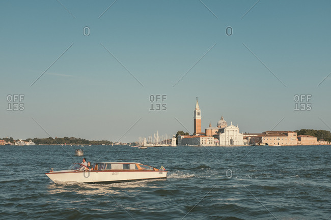 Venice, Italy - July 6, 2017: Men boating in Venice Italy