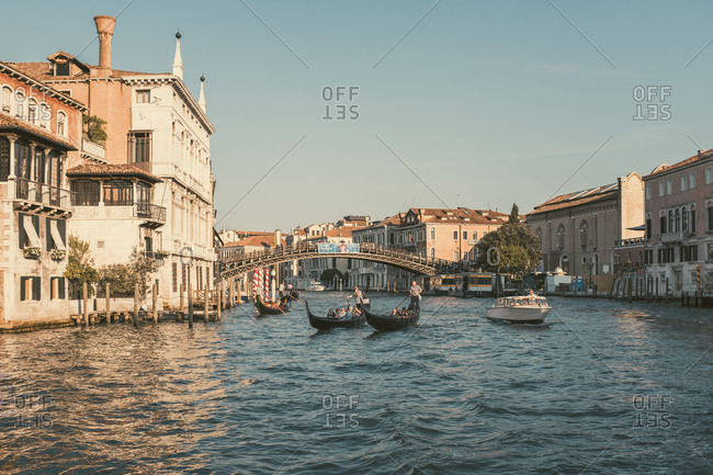 Venice, Italy - July 6, 2017: Several tour boats on a canal in Venice