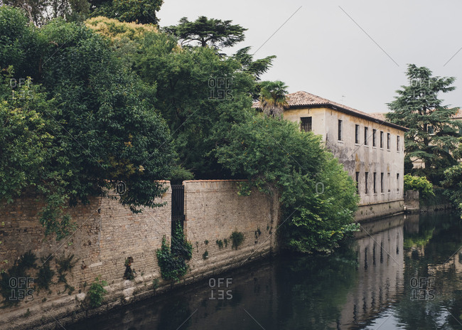 Building reflecting in a canal in Portogruaro, Italy