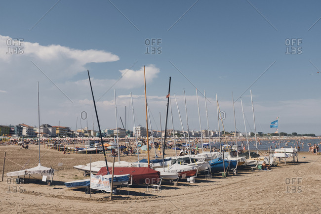 Caorle, Italy - July 10, 2017: Sailboats on a beach