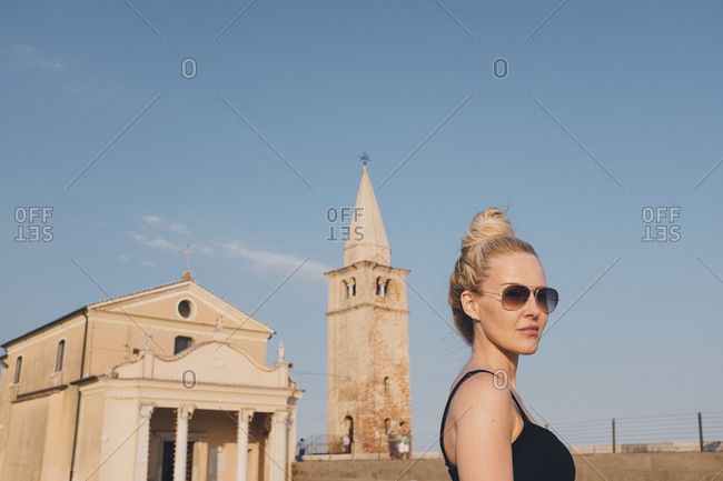 Blonde woman in sightseeing in Caorle, Italy