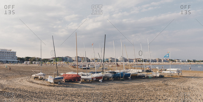 Caorle, Italy - July 10, 2017: Sailboats on a beach in Caorle, Italy