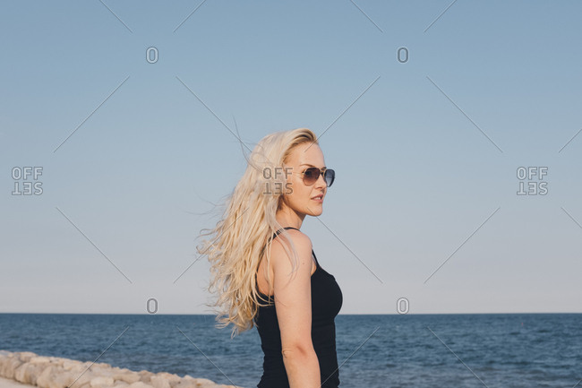 Woman on the coast of Caorle, Italy