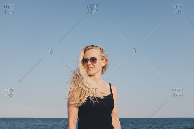 Blonde woman on the coast of Caorle, Italy