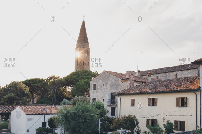 Sunrise behind tower in Caorle, Italy
