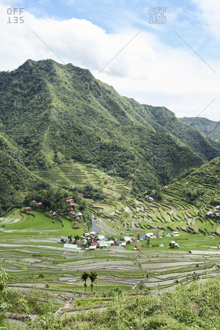 View of valley of Batad surrounded by rice terraces and houses. Batad, Philippines.