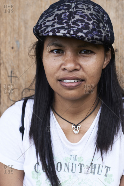 Batad, Philippines - March 3, 2018: Portrait of a pretty filipina woman wearing hat and smiling at camera.