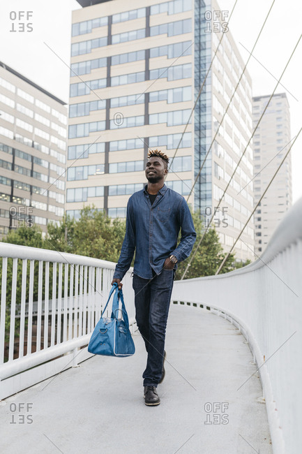 African man walking after work at outdoors in Barcelona
