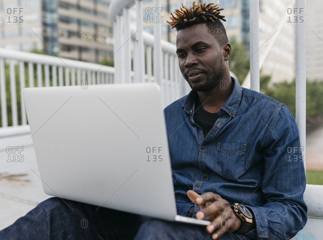 African man working at outdoors in Barcelona