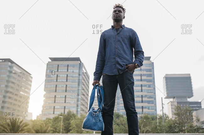 African man after work at outdoors in Barcelona