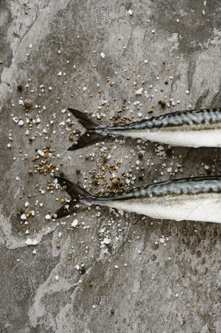 Tails of two fish with coarsely ground salt and seasonings