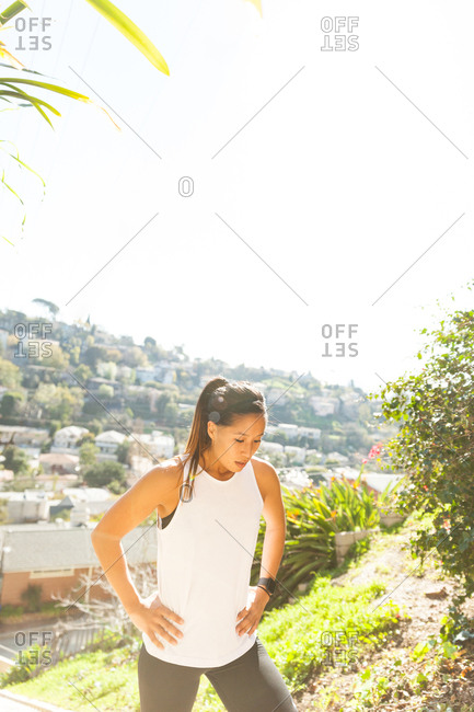 Woman resting while out for a jog