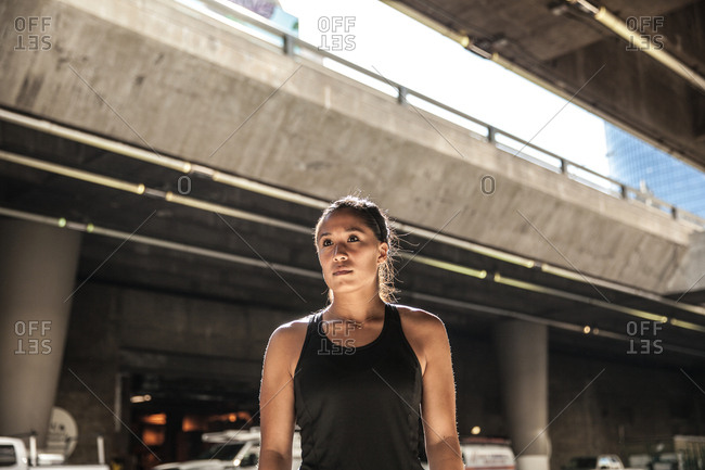 Portrait of a woman wearing an athletic tank top in the city