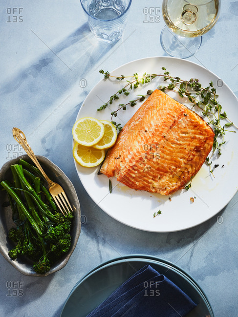 Salmon served with broccolini and white wine