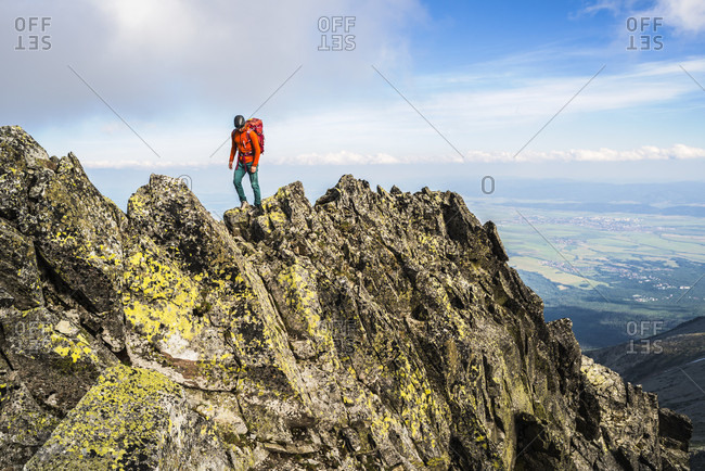Mountain climber at summit of Maly Kiezmarski Szczyt, Tatra Mountains, Slovakia