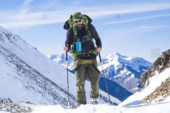 Front view of bearded back country skier in Ophir Pass, Ophir, Colorado, USA