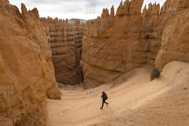 Single woman hiking in majestic scenery of Bryce Canyon National Park, Utah, USA