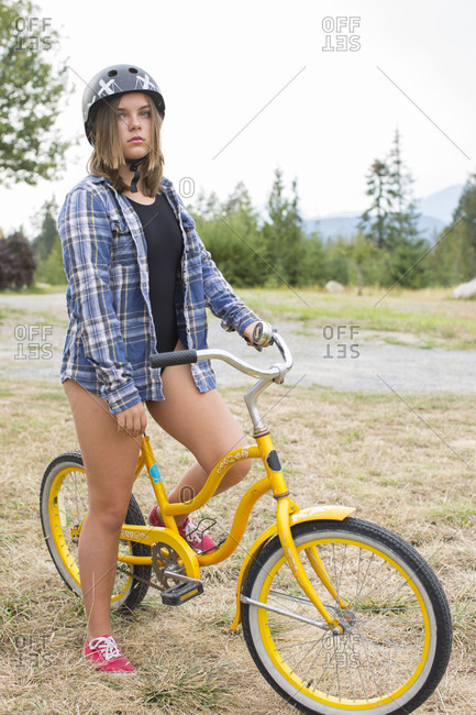 Girl on bicycle in natural setting