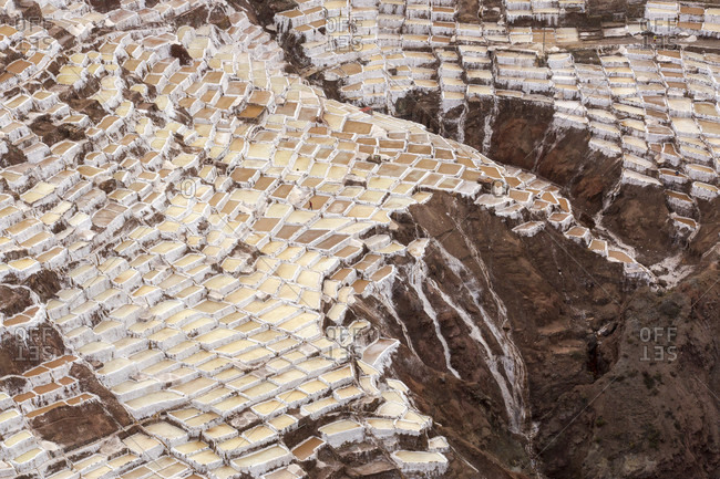 Aerial view of salt pans built on hillside, Maras, Cusco Region, Peru