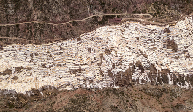Aerial view of salt pans built on mountainside of Sacred Valley of the Incas, Maras, Cusco region, Peru