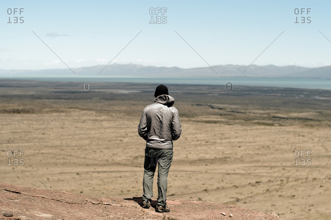 Rear view of man looking over vast Patagonian wilderness, El Chalten, Santa Cruz Province, Argentina