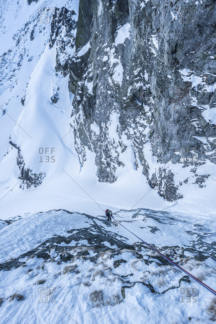 Directly above view of climber rappelling down mountain in Tatra Mountains, Slovakia