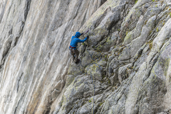 Climber rappelling down Aiguille du Grepon mountain in French Alps, Haute-Savoie, France
