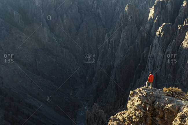Hiker standing on top of canyon in Black Canyon of Gunnison National Park, Colorado, USA